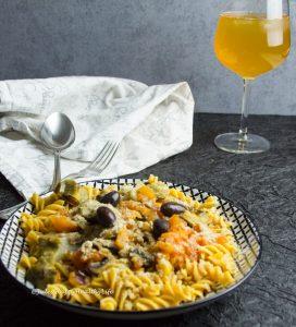 Gluten-free pasta with tomato, olives, artichoke