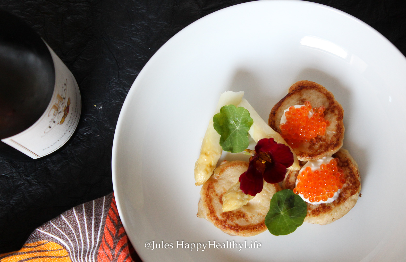 Delicious and juicy cauliflower blinis with salmon caviar